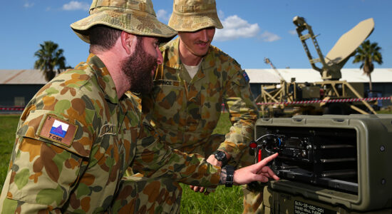 Australian Army signallers, Lance Corporal Josh Koitka (left) and Signaller Tim Price examine new communications equipment demonstrated at VIP day at Damascus Barracks in Brisbane.  The new equipment to be acquired for the Australian Army and Royal Australian Air Force.